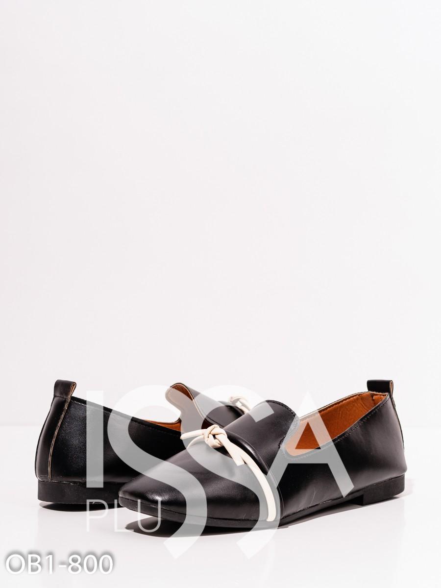 Черные кожаные туфли с бежевым декором