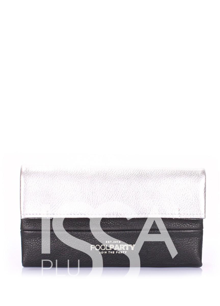 Черно-белая клатч-косметичка из натуральной кожи на одно отделение